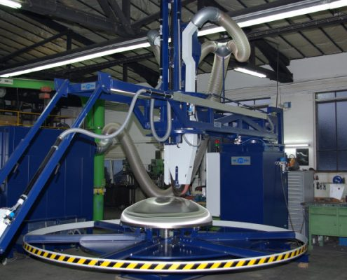 Belt grinding machine with turning device for the processing of boiler bottoms (BöSM – 4000)